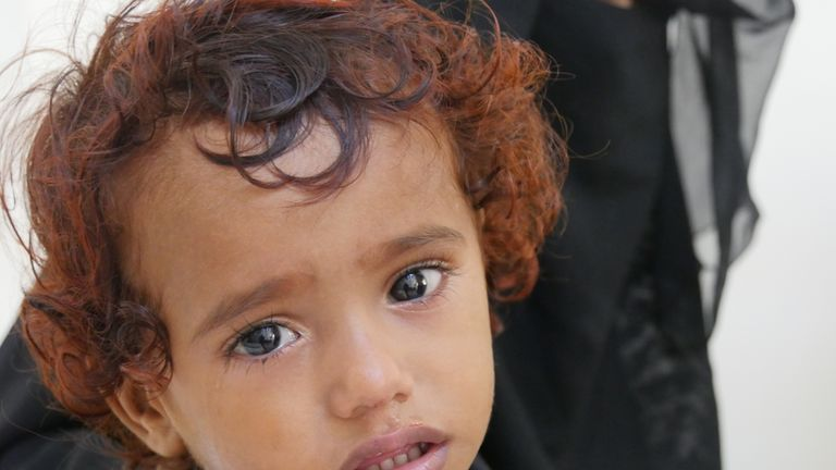 two-year-old son Aseel* . Pic: Ali Ashwal / Save the Children