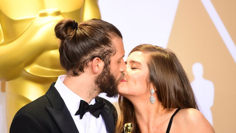 Chris Overton and Rachel Shenton with their Best Live Action Short Film Oscar for The Silent Child in the press room at the 90th Academy Awards held at the Dolby Theatre in Hollywood, Los Angeles, USA...PRESS ASSOCIATION Photo. Picture date: Sunday March 4, 2018. See PA Story SHOWBIZ Oscars. Photo credit should read: Ian West/PA Wire