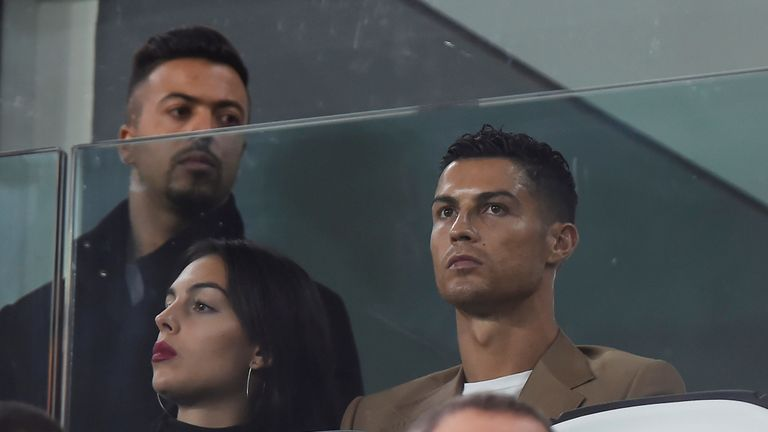 Ronaldo and his girlfriend (left) went to watch his club Juventus play on Tuesday