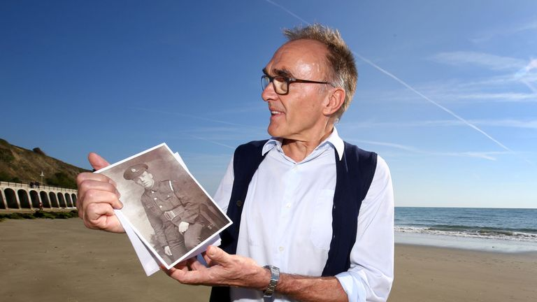 Filmmaker Danny Boyle holds a photograph of Private Walter Bleakley, who was from the same street where Danny went to school, as he announces plans for his Armistice Day commission