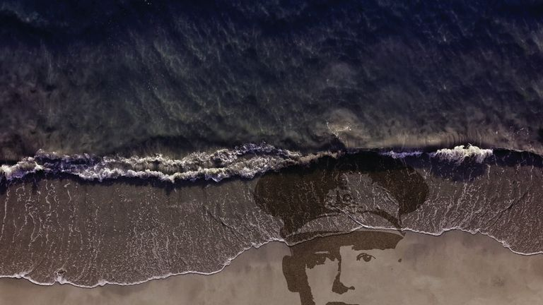 Artist impression of a sand portrait for Danny Boyle's Pages Of The Sea beaches project to mark the Armistice centenary