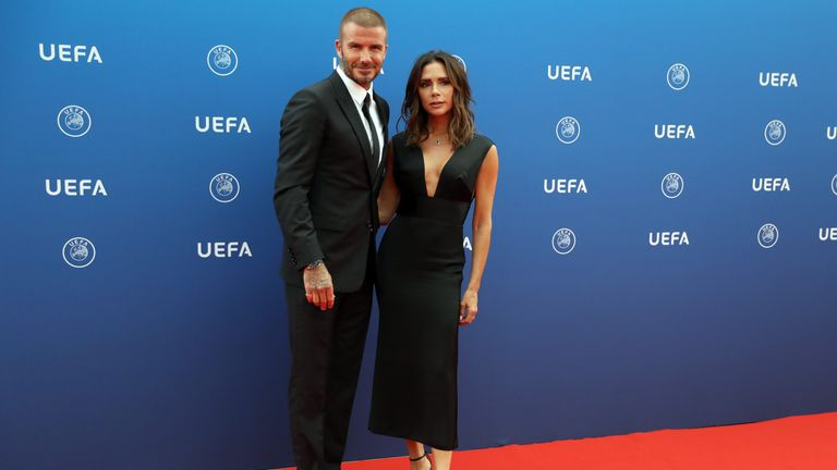 David Beckham and his wife Victoria arrive to attend the draw for UEFA Champions League