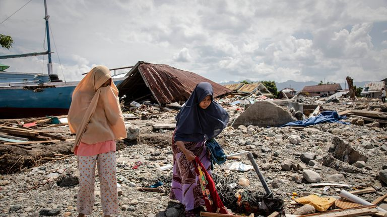 People search through the rubble of their homes in Donggala