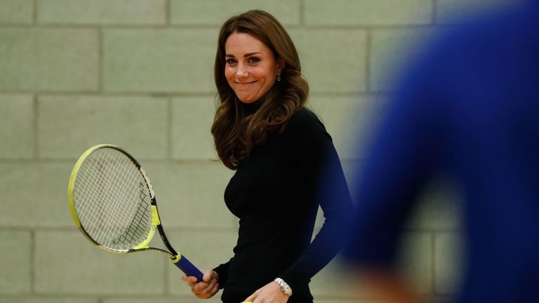 The Duchess of Cambridge plays tennis as she joins a session with a group during a visit to Coach Core Essex in Basildon