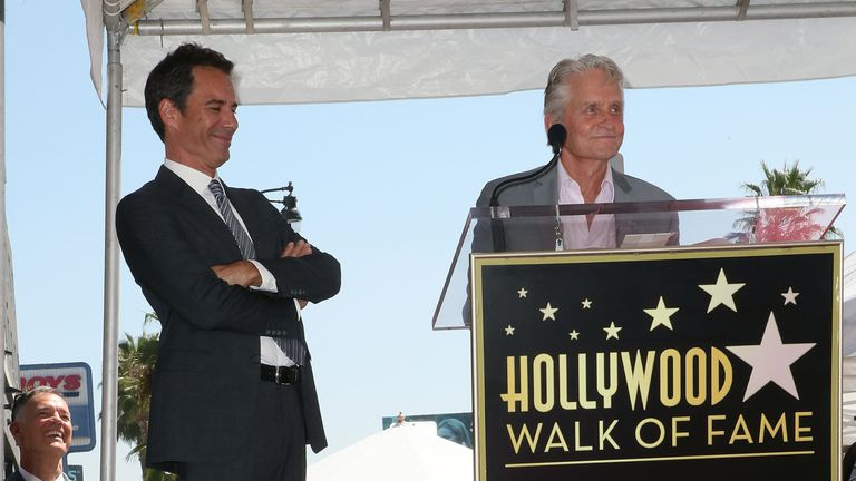 Eric McCormack (L) and Michael Douglas attend Eric McCormack being honored with a Star on the Hollywood Walk of Fame on September 13, 2018 in Hollywood, California. (Photo by David Livingston/Getty Images)