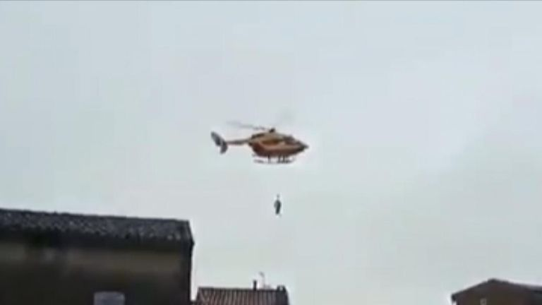 Helicopters are called in to help with rescue efforts in France following fatal floods