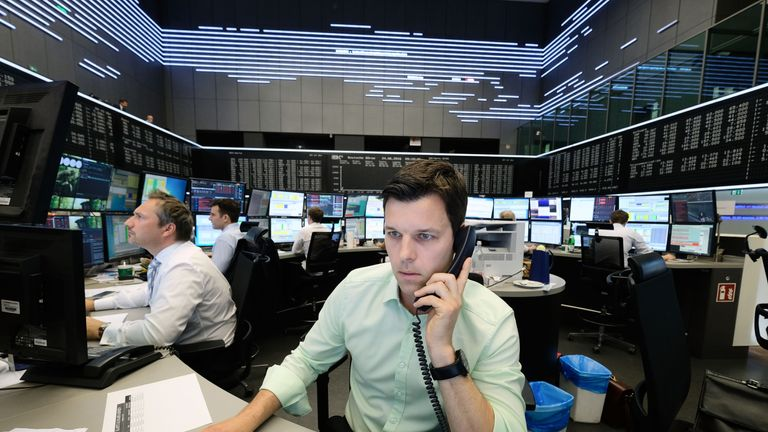 A trader sits at his desk at the Frankfurt Stock exchange the day after a majority of the British public voted for leaving the European Union on June 24, 2016 in Frankfurt am Main, Germany. Many prominent corporate CEOs and leading economists have warned that a Brexit would have strongly negative consequences for the British economy and repercussions across Europe as well