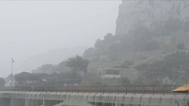 Heavy rain transforms a bridge in Italy into a waterfall