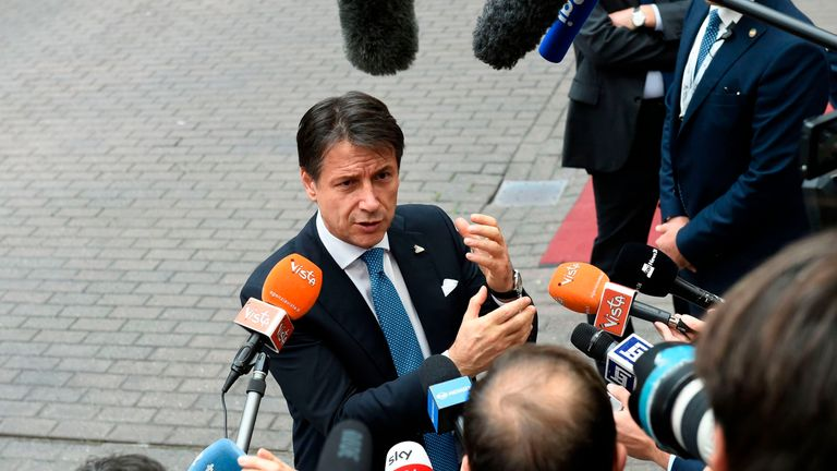 Italy's Prime Minister Giuseppe Conte gestures as he addresses media representatives after an EU - Korea Summit meeting at the European Council in Brussels on October 19, 2018