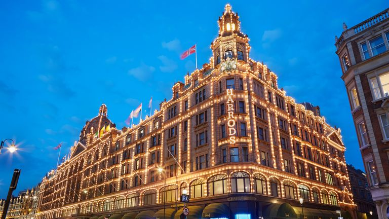 The famous Harrods department store illuminated in the evening of August 8, 2015 in London, UK. Harrods is the biggest department store in Europe.