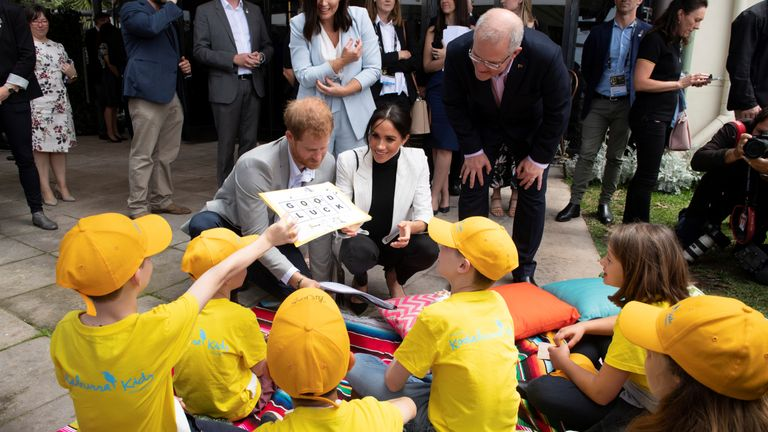 Harry and Meghan chat with school children while attending a lunchtime reception hosted by Australia's PM