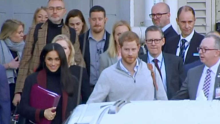 Britain's Prince Harry, center right, and his wife Meghan, center left, Duke and Duchess of Sussex, approach a car at an airport in Sydney, Monday, Oct. 15, 2018. Prince Harry and his wife Meghan arrived in Sydney on Monday, a day before they officially start a 16-day tour of Australia and the South Pacific.(Australian Pool via AP)