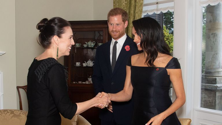 Britain's Prince Harry (C) and his wife Meghan (R), the Duchess of Sussex, meet with New Zealand's Prime Minister Jacinda Ardern (L) during a visit to Government House in Wellington on October 28, 2018