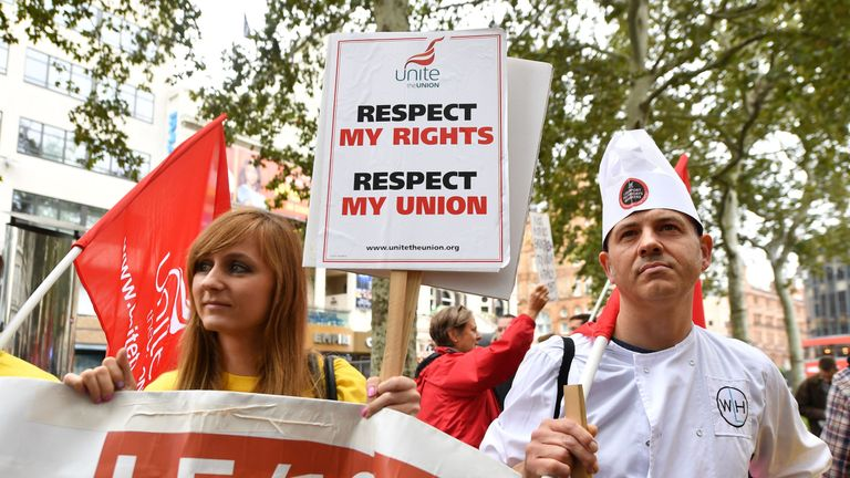 Protesters demonstrating about disputes over pay and union recognition at a rally in Leicester Square, London