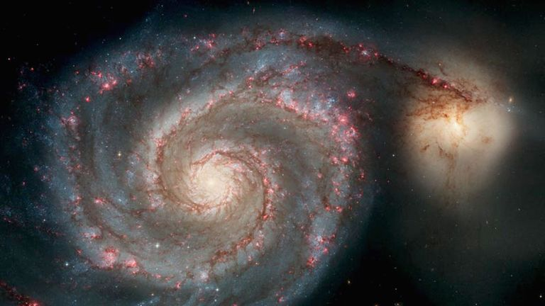 SPACE - APRIL 25: In this handout image released from the Hubble Space Telescope the Whirlpool Galaxy is seen , April 25, 2005 released for the Hubble 15th anniversary. Nasa's Space Telescope has obited the Earth for 15 years and has taken more than 700,000 images of the comos. This image is one of the sharpest images Hubble has ever produced, taken with the newest camera. (Photo by Hubble Space Telescope/Nasa via Getty Images)