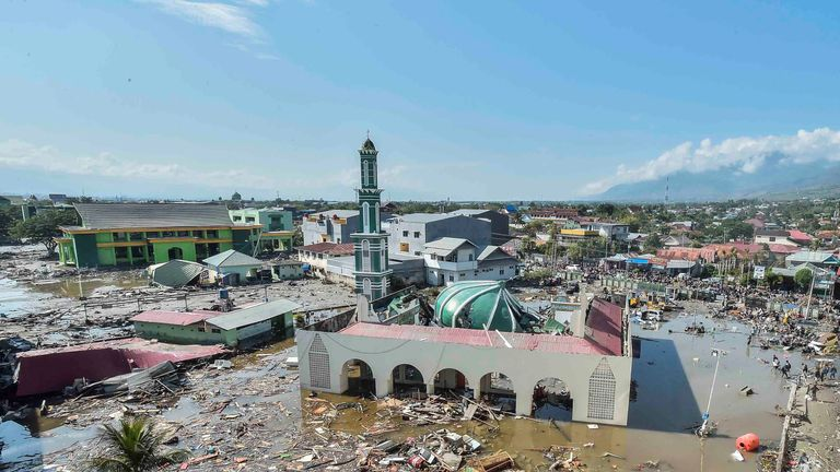 Debris surrounds a mosque in West Palu