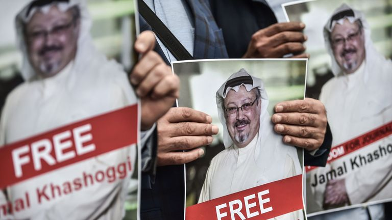 Protesters hold pictures of missing journalist Jamal Khashoggi during a demonstration