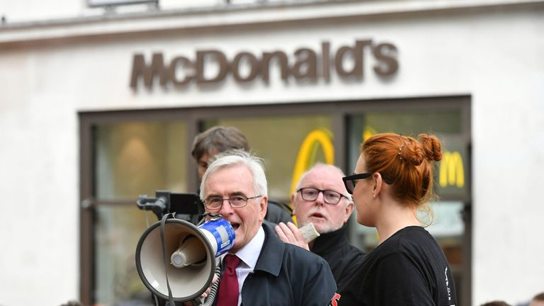 Shadow chancellor John McDonnell speaking at a rally about disputes over pay and union recognition in Leicester Square, London.