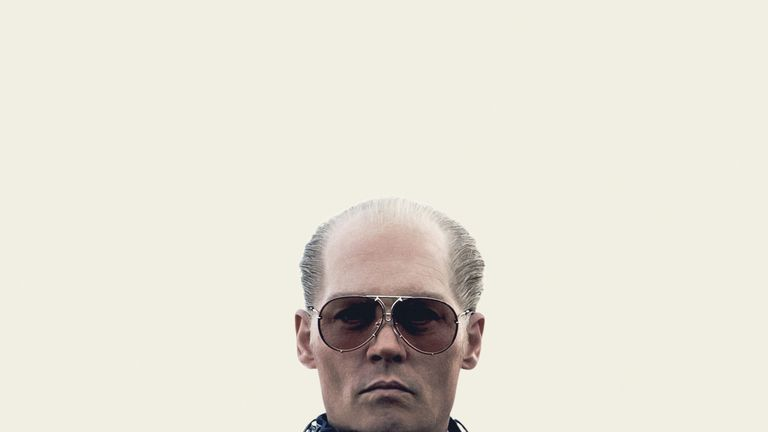 Johnny Depp as the Boston mob boss Whitey Bulger