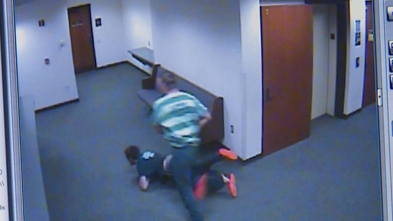 Two men flee a courtroom in Washington State, USA.