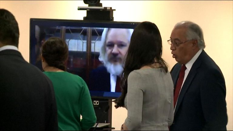 Julian Assange speaks on a videolink in the hearing for a lawsuit he has brought against Ecuador accusing them of infringing on his rights