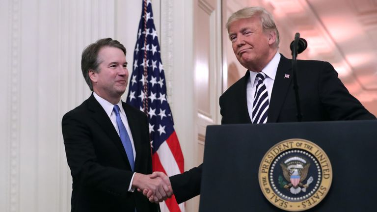 U.S. Supreme Court Justice Brett Kavanaugh (L) shakes hands with President Donald Trump during Kavanaugh's ceremonial swearing in in the East Room of the White House October 08, 2018 in Washington, DC