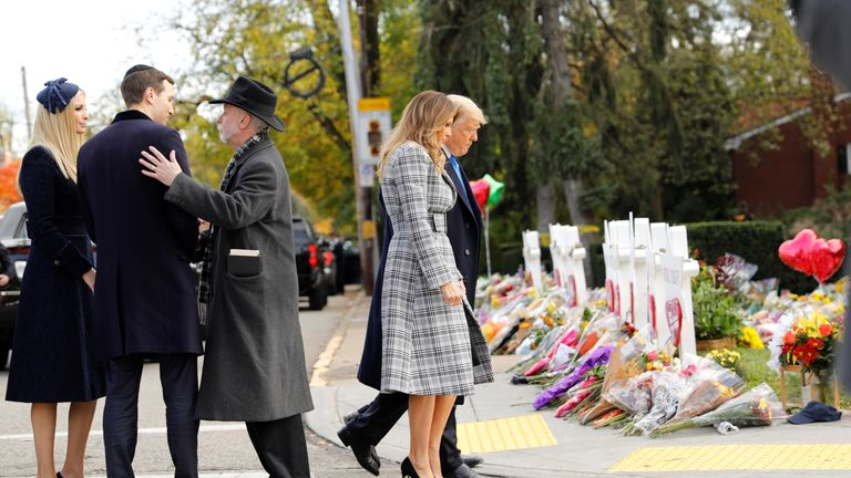 White House senior advisers Jared Kushner and Ivanka Trump speak with Rabbi Jeffrey Myers as U.S. President Donald Trump and first lady Melania Trump pay their respects outside the Tree of Life synagogue in the wake of the shooting at the synagogue where 11 people were killed and six people were wounded in Pittsburgh, Pennsylvania, U.S