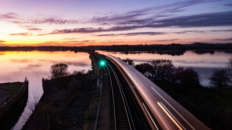 Winner of the Network Rail 'Lines in the Landscape' Award of the Landscape Photographer of the Year Awards, Sunset over Holes Bay, Dorset, England by Alan Courtney
