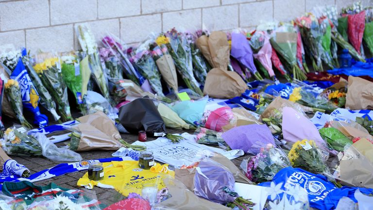 Leicester City fans leave flowers and tributes at the King Power Stadium after a helicopter crash involving Thai owner Vichai Srivaddhanaprabha