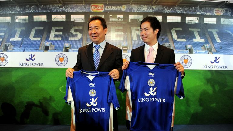 Chairman of Thailand's King Power duty free retailers group, Vichai Raksriaksorn (L), and his son and assistant Aiyawatt Raksiaksorn (R), hold Leicester City football club shirts during a takeover announcement in Bangkok on August 18, 2010