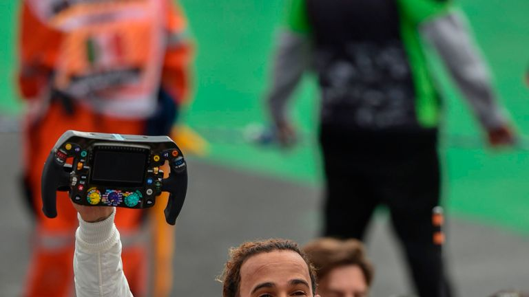Lewis Hamilton with his steering wheel after finishing fourth - and clinching the title