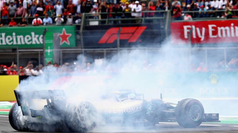 Lewis Hamilton performs doughnuts on the track after clinching his fifth world title in Mexico City