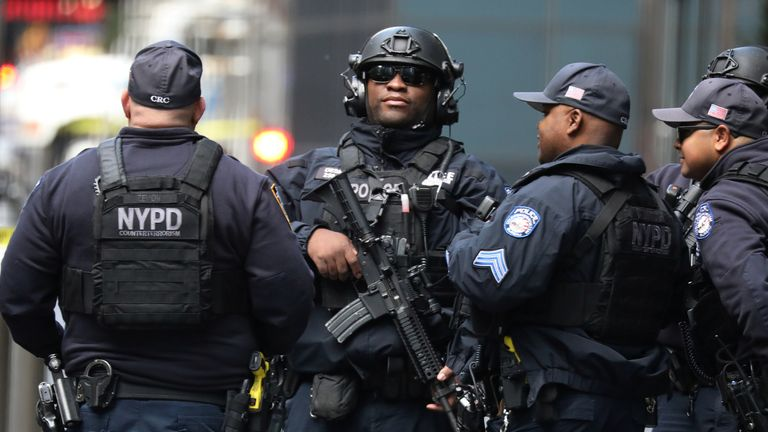 New York Police Department Counter Terrorism officers continue to investigate after a package sent to Time Warner Center