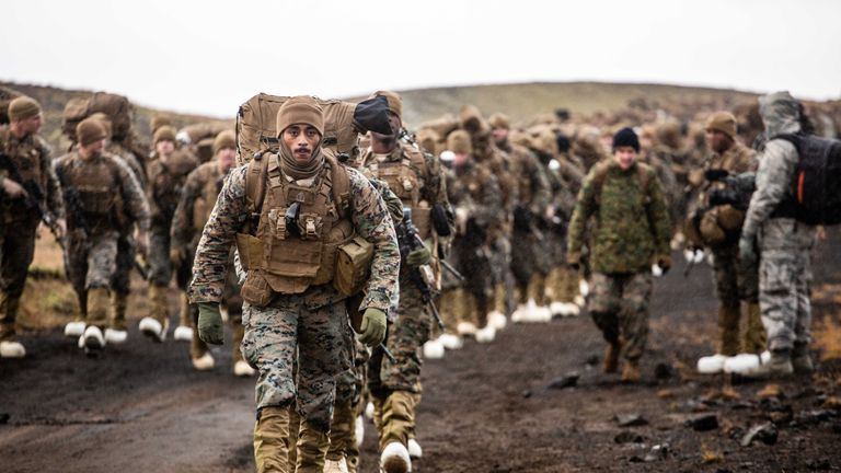 A line of 350 US Marines begins to march across the Icelandic terrain preparing for NATO...s Exercise Trident Juncture. Pic: Capt Kylee Ashton