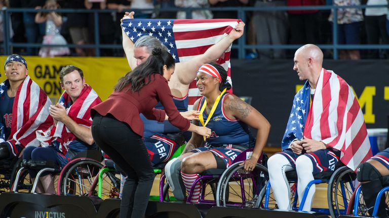The Duchess of Sussex meets members of the winning US team during the medal presentations at the Invictus Games 2018 wheelchair basketball final in Sydney