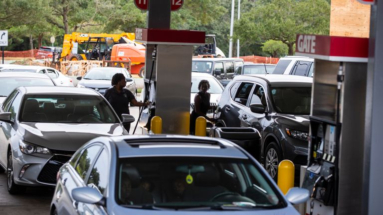 Drivers line up for gasoline as Hurricane Michael bears down on the northern Gulf coast of Florida on October 8, 2018 in Tallahassee, Florida