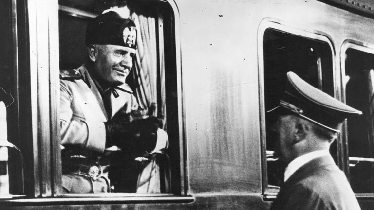 Benito Mussolini takes a train after a visit to Berlin in 1937