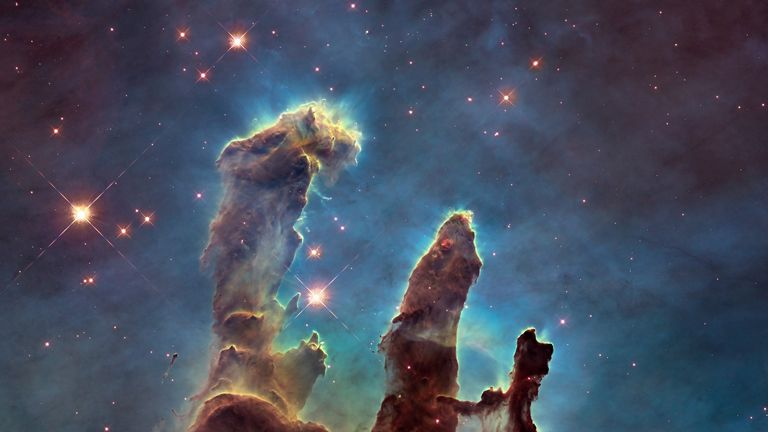 NASA's Hubble Space Telescope has revisited the famous Pillars of Creation, originally photographed in 1995, revealing a sharper and wider view of the structures in this visible-light image.