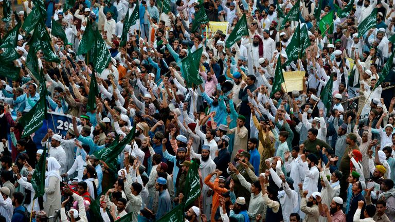 Demonstrators line the streets in Lahore calling for the hanging of Ms Bibi