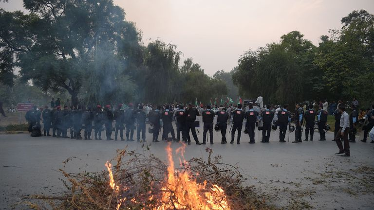 Pakistani riot policemen lineup on a blocked street leading to Pakistan's Supreme Court
