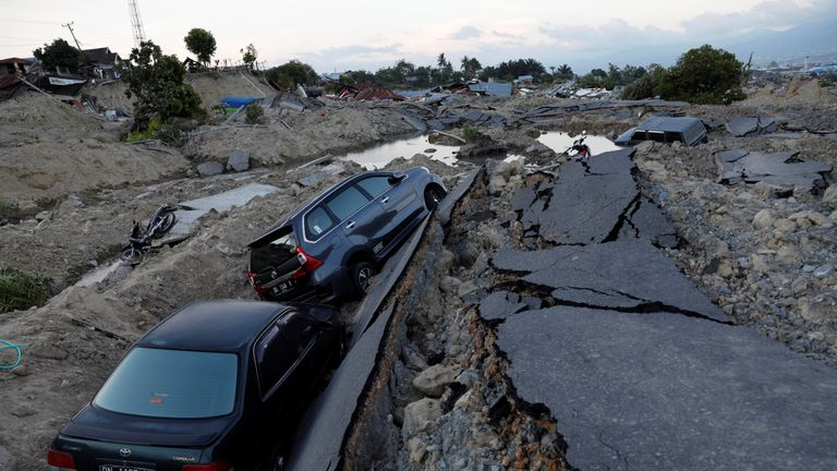 Cars trapped after sinking into the ground in the Balaroa sub-district of Palu