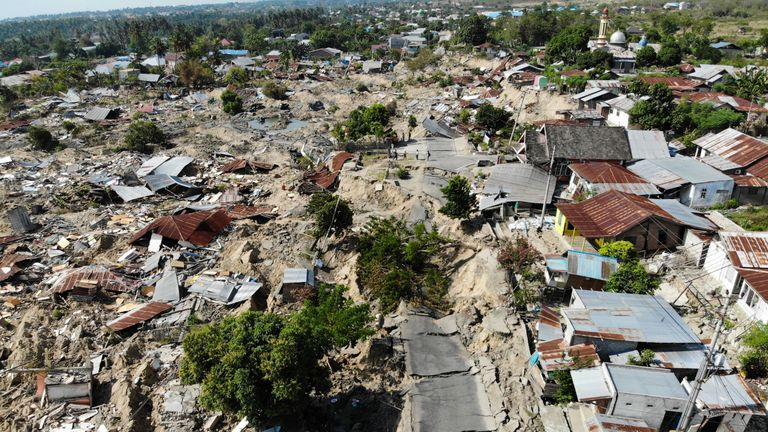 An area of Palu where shaking of the ground has caused roads to break up and houses to be swallowed