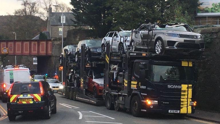 Luxury cars crushed as transporter crashes into bridge | UK