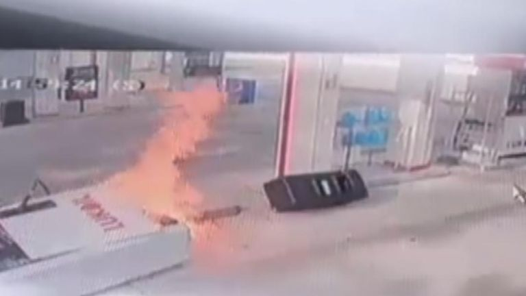 Petrol pump ignites after being pulled over by a car still attached via the hose
