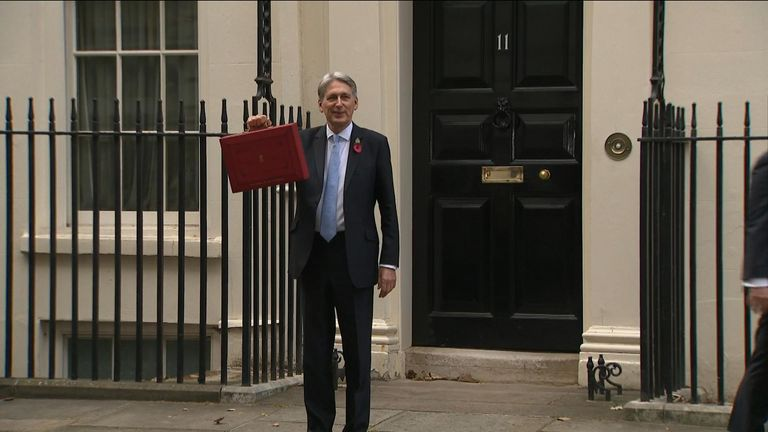 Philip Hammond showing the red box containing the budget
