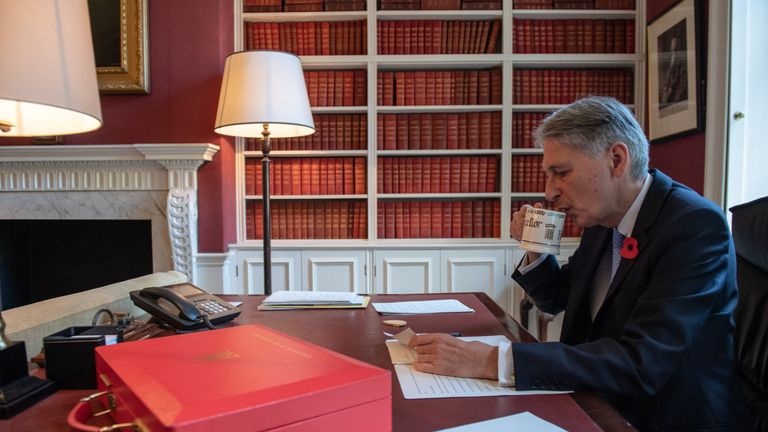 The chancellor enjoys a brew and a biscuit as he prepares Monday's budget
