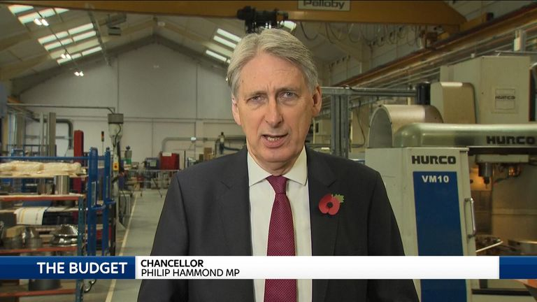 Chancellor of the Exchequer, Philip Hammond talking in factory.