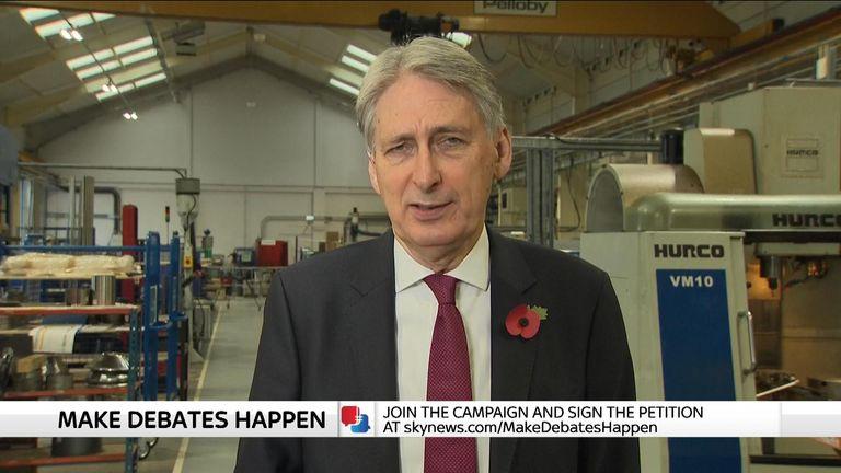 Philip Hammond talking in factory.