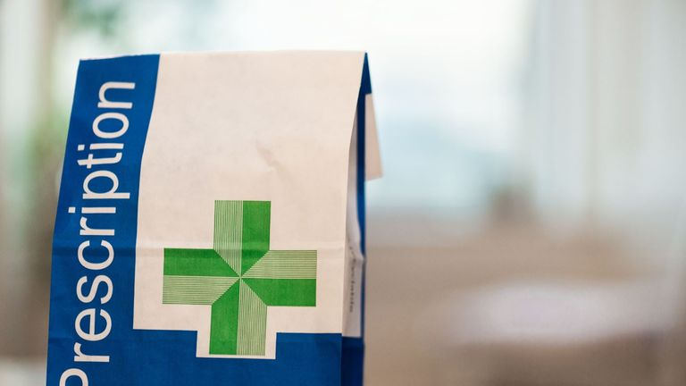 Prescription medicine in a paper bag - Stock image