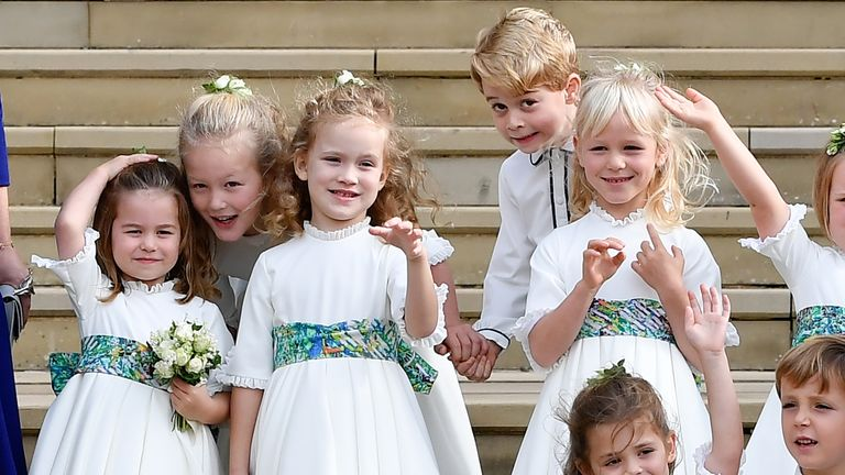 The bridesmaids and page boys, including Prince George of Cambridge (C right) and Princess Charlotte of Cambridge (L)
